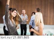 Купить «Group of young friends dancing», фото № 21881865, снято 4 ноября 2015 г. (c) Wavebreak Media / Фотобанк Лори