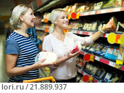 Купить «Adult girl with senior mother in cheese section of supermarket», фото № 21889937, снято 30 марта 2020 г. (c) Яков Филимонов / Фотобанк Лори