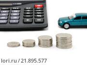 Купить «Монеты, калькулятор и автомобиль. Монеты, сложенные в столбики. Рост цен», эксклюзивное фото № 21895577, снято 20 февраля 2016 г. (c) Юрий Морозов / Фотобанк Лори