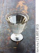 Купить «Винтажная рюмка с водкой на старом столе», фото № 21897813, снято 22 февраля 2016 г. (c) Андрей С / Фотобанк Лори