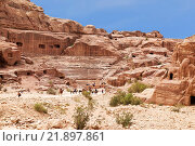 Купить «Tourists near the roman-era amphitheater carved into the pink sandstone at Petra, Jordan», фото № 21897861, снято 3 августа 2015 г. (c) Наталья Волкова / Фотобанк Лори