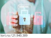 Купить «close up of hand with security lock on smartphone», фото № 21940389, снято 13 августа 2015 г. (c) Syda Productions / Фотобанк Лори