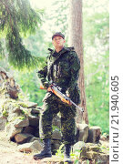 Купить «young soldier or hunter with gun in forest», фото № 21940605, снято 14 августа 2014 г. (c) Syda Productions / Фотобанк Лори