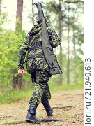 Купить «young soldier or hunter with gun in forest», фото № 21940613, снято 14 августа 2014 г. (c) Syda Productions / Фотобанк Лори