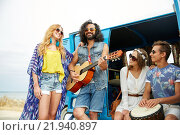 Купить «happy hippie friends playing music over minivan», фото № 21940897, снято 27 августа 2015 г. (c) Syda Productions / Фотобанк Лори