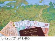 Купить «Железнодорожный билет, деньги и российский паспорт лежат на географической карте России», фото № 21941465, снято 26 февраля 2016 г. (c) Ирина Борсученко / Фотобанк Лори