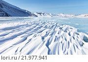 Купить «Байкал зимой. Красивый рельеф снежных заструг на льду озера в солнечный день», фото № 21977941, снято 28 февраля 2016 г. (c) Виктория Катьянова / Фотобанк Лори