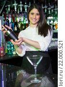 Купить «Pretty bartender mixing a cocktail drink in cocktail shaker», фото № 22000521, снято 22 сентября 2015 г. (c) Wavebreak Media / Фотобанк Лори