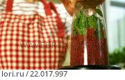 Купить «Woman is mixing a smoothie», видеоролик № 22017997, снято 9 апреля 2020 г. (c) Wavebreak Media / Фотобанк Лори