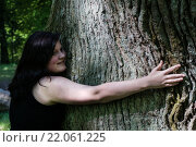 Купить «Young Woman hugging a Tree», фото № 22061225, снято 27 марта 2019 г. (c) PantherMedia / Фотобанк Лори