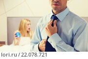 Купить «close up of man adjusting tie on neck in bedroom», фото № 22078721, снято 13 ноября 2014 г. (c) Syda Productions / Фотобанк Лори