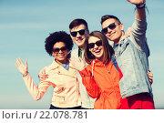 Купить «happy teenage friends in shades waving hands», фото № 22078781, снято 19 марта 2015 г. (c) Syda Productions / Фотобанк Лори