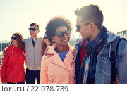 happy teenage friends in shades talking on street. Стоковое фото, фотограф Syda Productions / Фотобанк Лори