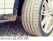 Купить «close up of dirty car wheel on ground», фото № 22079185, снято 28 марта 2015 г. (c) Syda Productions / Фотобанк Лори