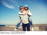 Купить «happy teenage couple in shades having fun outdoors», фото № 22079517, снято 19 марта 2015 г. (c) Syda Productions / Фотобанк Лори