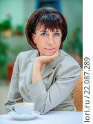 Купить «Beautiful businesswoman drinking coffee», фото № 22087289, снято 25 мая 2018 г. (c) easy Fotostock / Фотобанк Лори