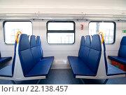 Пассажирские сидения в салоне электропоезда ЭП2Д (2016 год). Редакционное фото, фотограф Павел Сарычев / Фотобанк Лори