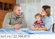 Serious parents discussing parental guardianship. Стоковое фото, фотограф Яков Филимонов / Фотобанк Лори