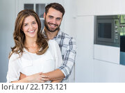 Купить «Happy young couple embracing at home», фото № 22173121, снято 6 ноября 2015 г. (c) Wavebreak Media / Фотобанк Лори