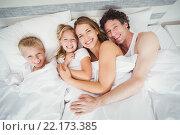 Купить «High angle view portrait of happy family relaxing on bed», фото № 22173385, снято 10 ноября 2015 г. (c) Wavebreak Media / Фотобанк Лори