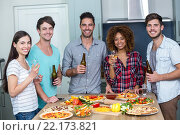 Купить «Happy multi-ethnic enjoying alcohol and pizza at table», фото № 22173821, снято 13 ноября 2015 г. (c) Wavebreak Media / Фотобанк Лори