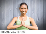 Купить «Composite image of smiling sporty woman doing yoga», фото № 22213145, снято 21 февраля 2020 г. (c) Wavebreak Media / Фотобанк Лори