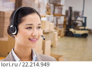 Купить «Composite image of happy operator posing with a headset», фото № 22214949, снято 17 ноября 2018 г. (c) Wavebreak Media / Фотобанк Лори