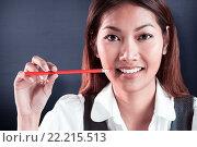 Купить «Composite image of smiling businesswoman holding a pencil», фото № 22215513, снято 21 октября 2018 г. (c) Wavebreak Media / Фотобанк Лори