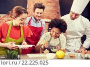Купить «happy friends and chef cook baking in kitchen», фото № 22225025, снято 12 февраля 2015 г. (c) Syda Productions / Фотобанк Лори