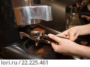 Купить «close up of woman making coffee by machine at cafe», фото № 22225461, снято 1 декабря 2015 г. (c) Syda Productions / Фотобанк Лори