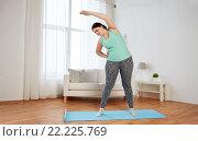 Купить «plus size woman exercising on mat at home», фото № 22225769, снято 21 февраля 2016 г. (c) Syda Productions / Фотобанк Лори