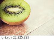 Купить «close up of ripe kiwi slice on table», фото № 22225825, снято 17 марта 2015 г. (c) Syda Productions / Фотобанк Лори