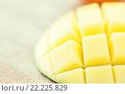 Купить «close up of ripe mango slice on table», фото № 22225829, снято 17 марта 2015 г. (c) Syda Productions / Фотобанк Лори