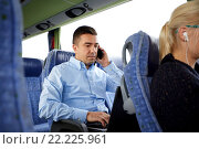 Купить «man with smartphone and laptop in travel bus», фото № 22225961, снято 21 октября 2015 г. (c) Syda Productions / Фотобанк Лори