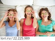 Купить «happy young women with cucumber mask lying in bed», фото № 22225989, снято 14 ноября 2015 г. (c) Syda Productions / Фотобанк Лори