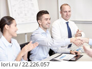 Купить «smiling business team shaking hands in office», фото № 22226057, снято 25 октября 2014 г. (c) Syda Productions / Фотобанк Лори