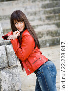 Купить «Attractive young woman in a Red jacket and denim pants», фото № 22228817, снято 23 октября 2018 г. (c) age Fotostock / Фотобанк Лори