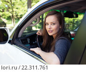 Купить «Beautiful young happy woman in car.», фото № 22311761, снято 8 июня 2015 г. (c) Валуа Виталий / Фотобанк Лори