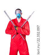Мужчина в маске держит в руках сверла дрели. Стоковое фото, фотограф Myroslav Kuchynskyi / Фотобанк Лори