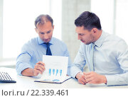 Купить «businessmen with notebook on meeting», фото № 22339461, снято 9 июня 2013 г. (c) Syda Productions / Фотобанк Лори
