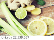 close up of ginger, celery and lemon on table. Стоковое фото, фотограф Syda Productions / Фотобанк Лори