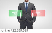 Купить «close up of businessman with yes and no buttons», фото № 22339589, снято 15 марта 2014 г. (c) Syda Productions / Фотобанк Лори