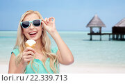 Купить «happy woman in sunglasses with ice cream on beach», фото № 22339713, снято 13 февраля 2016 г. (c) Syda Productions / Фотобанк Лори