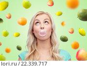 Купить «happy young woman or teenage girl chewing gum», фото № 22339717, снято 13 февраля 2016 г. (c) Syda Productions / Фотобанк Лори