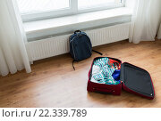 Купить «close up of travel bag with clothes and backpack», фото № 22339789, снято 9 февраля 2016 г. (c) Syda Productions / Фотобанк Лори