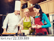 Купить «happy women and chef cook baking in kitchen», фото № 22339889, снято 12 февраля 2015 г. (c) Syda Productions / Фотобанк Лори