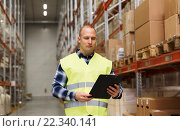 Купить «man with clipboard in safety vest at warehouse», фото № 22340141, снято 9 декабря 2015 г. (c) Syda Productions / Фотобанк Лори