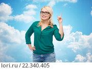 Купить «young woman with eyeglasses pointing finger up», фото № 22340405, снято 7 февраля 2016 г. (c) Syda Productions / Фотобанк Лори