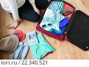 Купить «close up of woman packing travel bag for vacation», фото № 22340521, снято 9 февраля 2016 г. (c) Syda Productions / Фотобанк Лори