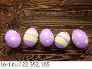 Купить «Easter eggs on wooden background», фото № 22352105, снято 20 апреля 2018 г. (c) PantherMedia / Фотобанк Лори